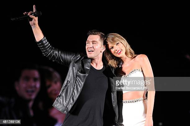 Andy Grammer and Taylor Swift perform during The 1989 Tour at Soldier Field on July 18 2015 in Chicago Illinois