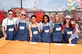 Andy Grammer Jeff Perry Kelly McCreary Aja Naomi King Cheryl Hines and Samantha Harris volunteer at the Feeding America Holiday Harvest event at...