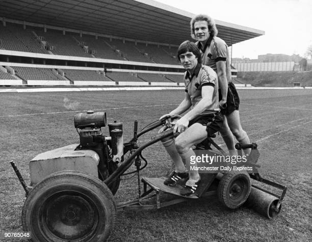 Andy Gray and John Richards of Wolverhampton Wanderers FC joke on a lawn mower Gray began his career at Dundee United before moving to Aston Villa He...
