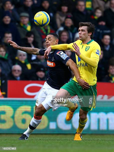 Andy Gray of Luton Town battles with Jonathan Howson of Norwich City during the FA Cup with Budweiser fourth round match between Norwich City and...