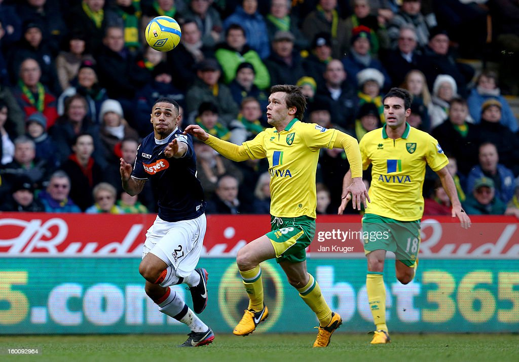 Andy Gray of Luton Town battles with Jonathan Howson of Norwich City during the FA Cup with Budweiser fourth round match between Norwich City and Luton Town at Carrow Road on January 26, 2013 in Norwich, England.