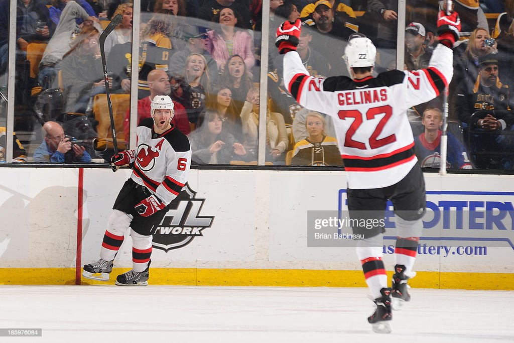 Andy Greene #6 and Eric Gelinas #22 of the New Jersey Devils celebrate a goal against the Boston Bruins at the TD Garden on October 26, 2013 in Boston, Massachusetts.