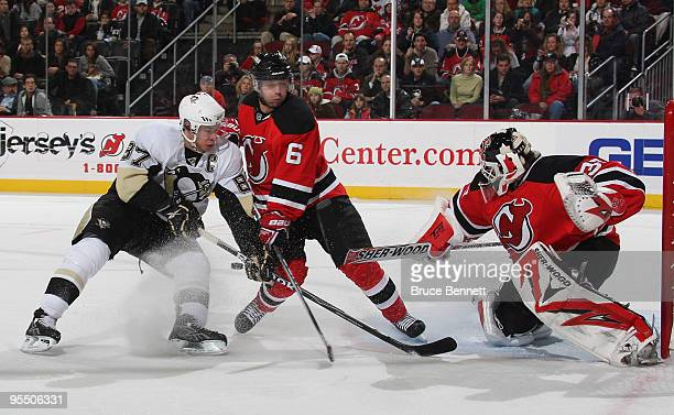 Andy Greene and goaltender Martin Brodeur of the New Jersey Devils combine to stop Sidney Crosby of the Pittsburgh Penguins at the Prudential Center...
