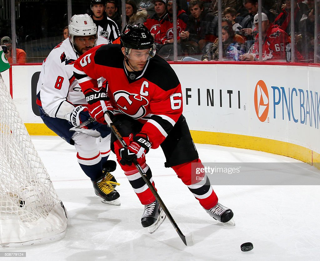 <a gi-track='captionPersonalityLinkClicked' href=/galleries/search?phrase=Andy+Greene&family=editorial&specificpeople=3568726 ng-click='$event.stopPropagation()'>Andy Greene</a> #6 of the New Jersey Devils and Alex Ovechkin #8 of the Washington Capitals fight for the puck on February 6, 2016 at Prudential Center in Newark, New Jersey.The Washington Capitals defeated the New Jersey Devils 3-2 in an overtime shootout.