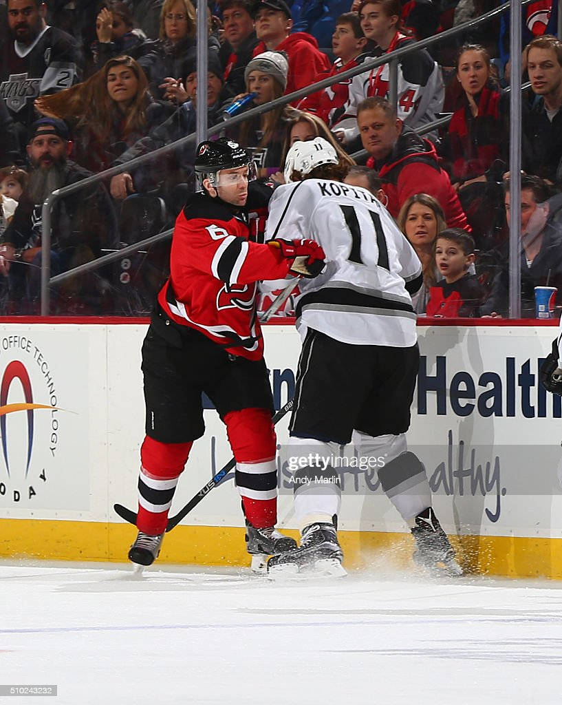 <a gi-track='captionPersonalityLinkClicked' href=/galleries/search?phrase=Andy+Greene&family=editorial&specificpeople=3568726 ng-click='$event.stopPropagation()'>Andy Greene</a> #6 of the New Jersey Devils and <a gi-track='captionPersonalityLinkClicked' href=/galleries/search?phrase=Anze+Kopitar&family=editorial&specificpeople=634911 ng-click='$event.stopPropagation()'>Anze Kopitar</a> #11 of the Los Angeles Kings come together near the boards during the game at the Prudential Center on February 14, 2016 in Newark, New Jersey.