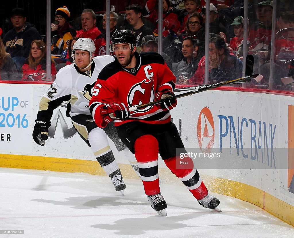 Andy Greene of the New Jersey Devils and Patric Hornqvist of the Pittsburgh Penguins skate on March 6 2016 at Prudential Center in Newark New...