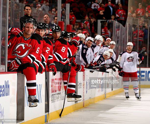Andy Greene of the New Jersey Devils and the rest of the players on the benches watch a fight at the end of the game against the Columbus Blue...