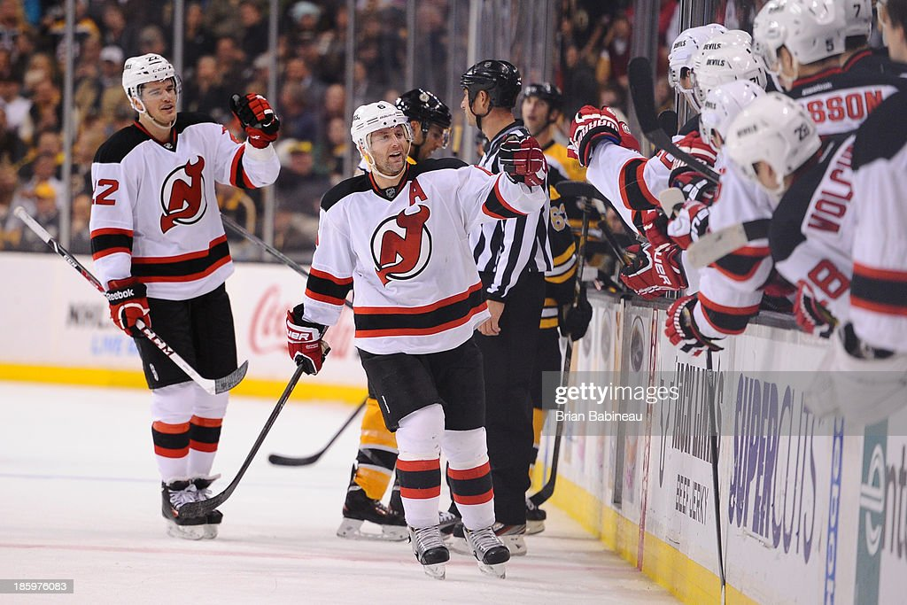 <a gi-track='captionPersonalityLinkClicked' href=/galleries/search?phrase=Andy+Greene&family=editorial&specificpeople=3568726 ng-click='$event.stopPropagation()'>Andy Greene</a> #6 of the New Jersey Devils celebrates a goal against the Boston Bruins at the TD Garden on October 26, 2013 in Boston, Massachusetts.