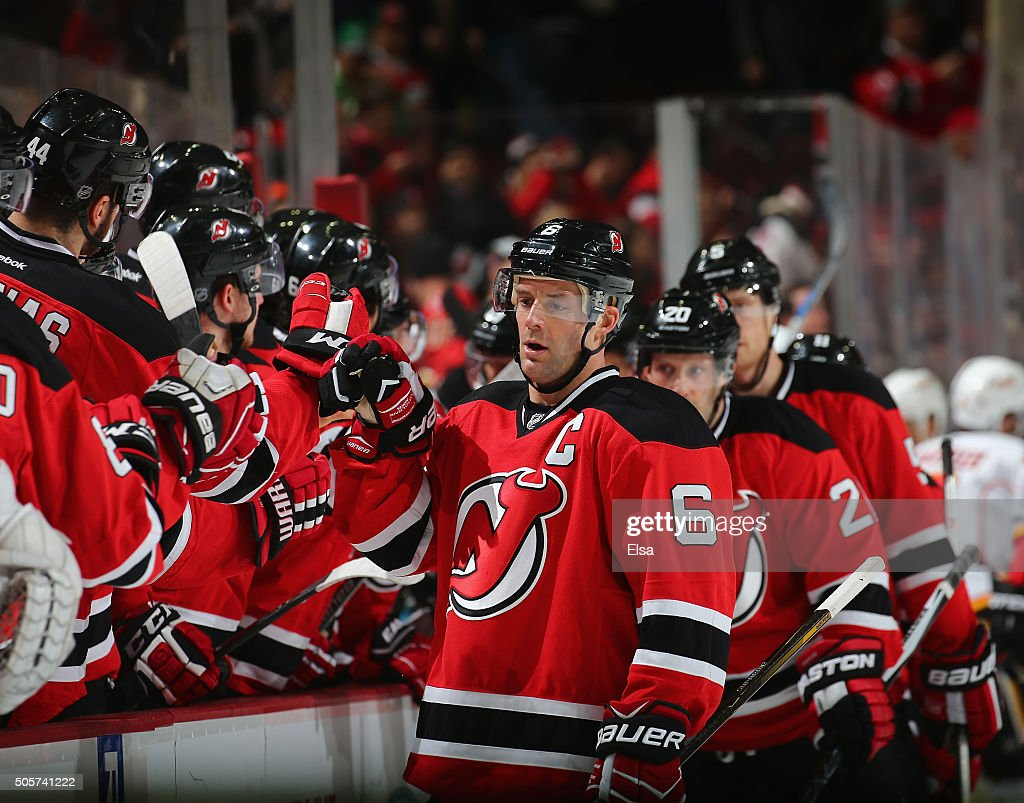 <a gi-track='captionPersonalityLinkClicked' href=/galleries/search?phrase=Andy+Greene&family=editorial&specificpeople=3568726 ng-click='$event.stopPropagation()'>Andy Greene</a> #6 of the New Jersey Devils celebrates his empty net goal with teammates on the bench in the third period against the Calgary Flames on January 19,2016 at Prudential Center in Newark, New Jersey.The New Jersey Devils defeated the Calgary Flames 4-2.