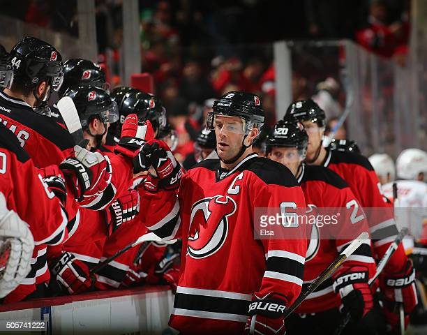Andy Greene of the New Jersey Devils celebrates his empty net goal with teammates on the bench in the third period against the Calgary Flames on...