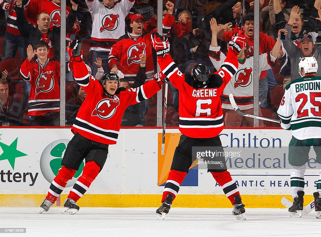 <a gi-track='captionPersonalityLinkClicked' href=/galleries/search?phrase=Andy+Greene&family=editorial&specificpeople=3568726 ng-click='$event.stopPropagation()'>Andy Greene</a> #6 of the New Jersey Devils celebrates his overtime goal against the Minnesota Wild with teammate <a gi-track='captionPersonalityLinkClicked' href=/galleries/search?phrase=Patrik+Elias&family=editorial&specificpeople=201827 ng-click='$event.stopPropagation()'>Patrik Elias</a> #26 at the Prudential Center on March 20, 2014 in Newark, New Jersey.