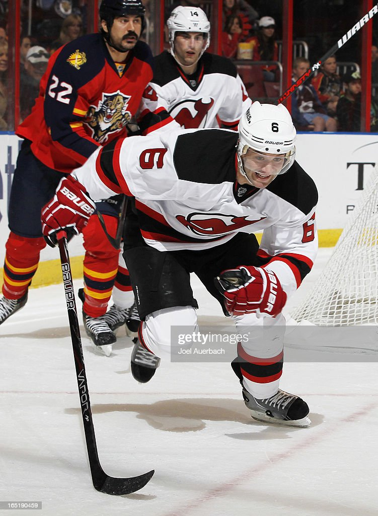 Andy Greene #6 of the New Jersey Devils chases a puck to the boards against the Florida Panthers at the BB&T Center on March 30, 2013 in Sunrise, Florida. The Panthers defeated the Devils 3-2 in overtime.