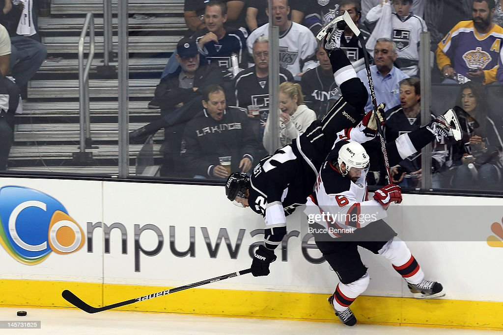 <a gi-track='captionPersonalityLinkClicked' href=/galleries/search?phrase=Andy+Greene&family=editorial&specificpeople=3568726 ng-click='$event.stopPropagation()'>Andy Greene</a> #6 of the New Jersey Devils checks <a gi-track='captionPersonalityLinkClicked' href=/galleries/search?phrase=Trevor+Lewis&family=editorial&specificpeople=543187 ng-click='$event.stopPropagation()'>Trevor Lewis</a> #22 of the Los Angeles Kings in the third period of Game Three of the 2012 Stanley Cup Final at Staples Center on June 4, 2012 in Los Angeles, California.
