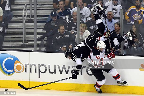 Andy Greene of the New Jersey Devils checks Trevor Lewis of the Los Angeles Kings in the third period of Game Three of the 2012 Stanley Cup Final at...
