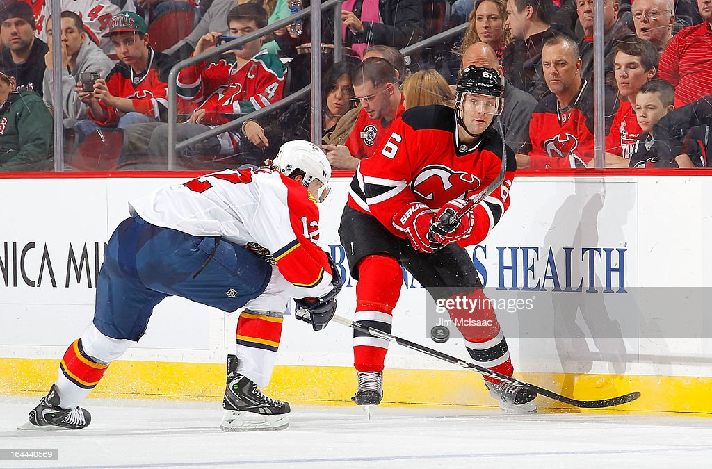 <a gi-track='captionPersonalityLinkClicked' href=/galleries/search?phrase=Andy+Greene&family=editorial&specificpeople=3568726 ng-click='$event.stopPropagation()'>Andy Greene</a> #6 of the New Jersey Devils clears the puck against <a gi-track='captionPersonalityLinkClicked' href=/galleries/search?phrase=Jack+Skille&family=editorial&specificpeople=697014 ng-click='$event.stopPropagation()'>Jack Skille</a> #12 of the Florida Panthers at the Prudential Center on March 23, 2013 in Newark, New Jersey.