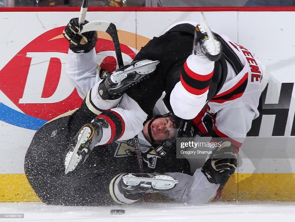 <a gi-track='captionPersonalityLinkClicked' href=/galleries/search?phrase=Andy+Greene&family=editorial&specificpeople=3568726 ng-click='$event.stopPropagation()'>Andy Greene</a> #6 of the New Jersey Devils collides with <a gi-track='captionPersonalityLinkClicked' href=/galleries/search?phrase=Sidney+Crosby&family=editorial&specificpeople=212781 ng-click='$event.stopPropagation()'>Sidney Crosby</a> #87 of the Pittsburgh Penguins on March 25, 2012 at Consol Energy Center in Pittsburgh, Pennsylvania. Pittsburgh won the game 5-2.