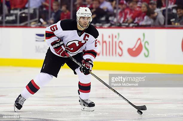 Andy Greene of the New Jersey Devils controls the puck against the Washington Capitals in the second period during the Capitals NHL season opener at...