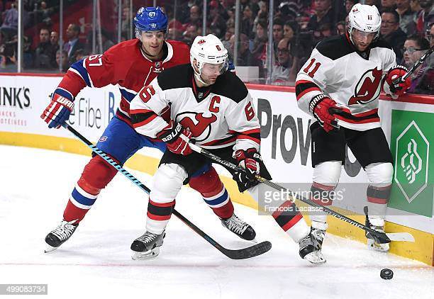 Andy Greene of the New Jersey Devils controls the puck while being challenged by Max Pacioretty of the Montreal Canadiens in the NHL game at the Bell...