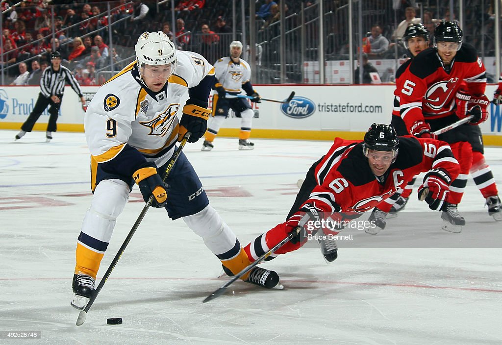 <a gi-track='captionPersonalityLinkClicked' href=/galleries/search?phrase=Andy+Greene&family=editorial&specificpeople=3568726 ng-click='$event.stopPropagation()'>Andy Greene</a> #6 of the New Jersey Devils dives to block a shot by <a gi-track='captionPersonalityLinkClicked' href=/galleries/search?phrase=Filip+Forsberg&family=editorial&specificpeople=8768623 ng-click='$event.stopPropagation()'>Filip Forsberg</a> #9 of the Nashville Predators during the third period at the Prudential Center on October 13, 2015 in Newark, New Jersey. The Predators defeated the Devils 3-1.