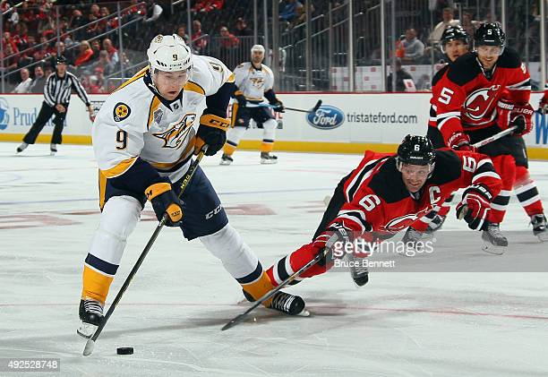 Andy Greene of the New Jersey Devils dives to block a shot by Filip Forsberg of the Nashville Predators during the third period at the Prudential...