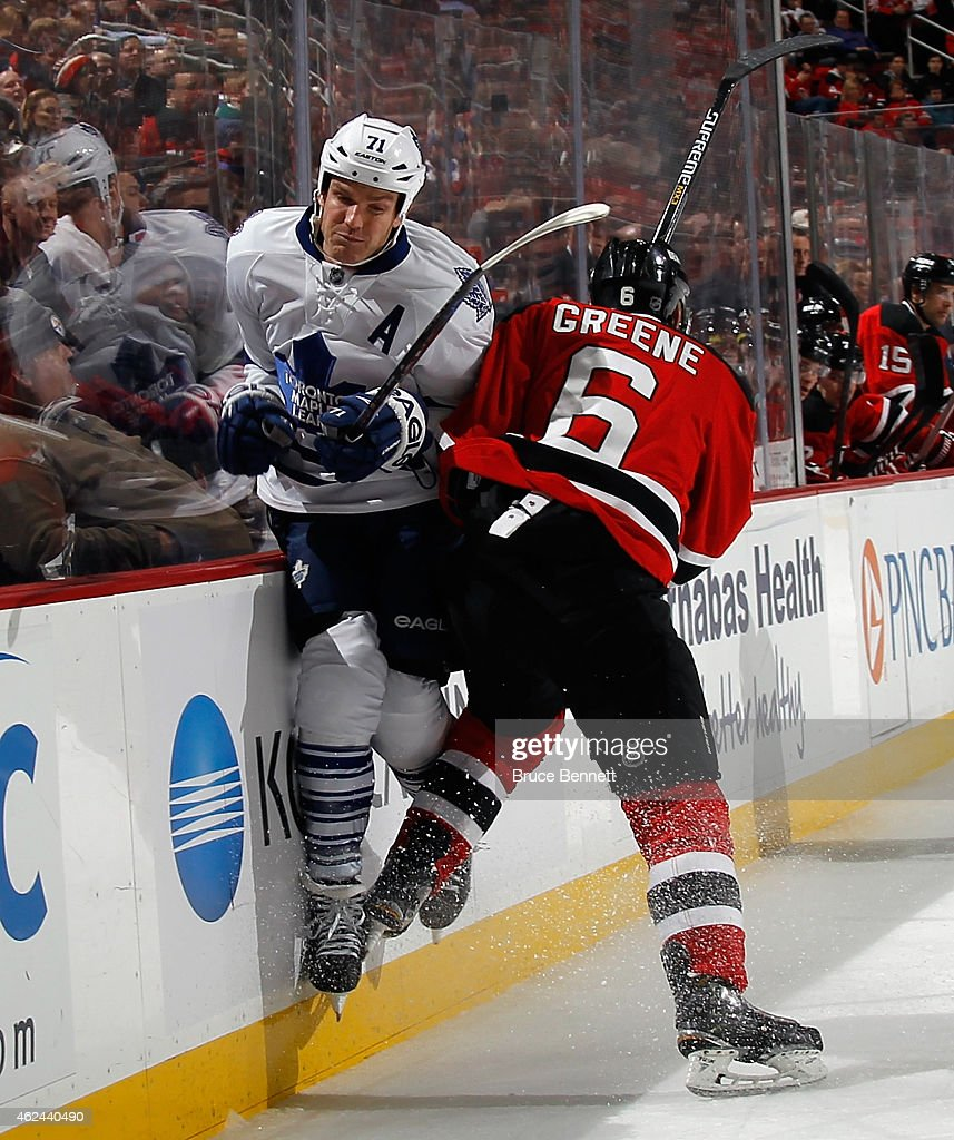 <a gi-track='captionPersonalityLinkClicked' href=/galleries/search?phrase=Andy+Greene&family=editorial&specificpeople=3568726 ng-click='$event.stopPropagation()'>Andy Greene</a> #6 of the New Jersey Devils hits <a gi-track='captionPersonalityLinkClicked' href=/galleries/search?phrase=David+Clarkson+-+Ice+Hockey+Player&family=editorial&specificpeople=2207489 ng-click='$event.stopPropagation()'>David Clarkson</a> #71 of the Toronto Maple Leafs during the third period at the Prudential Center on January 28, 2015 in Newark, New Jersey. The Devils defeated the Maple Leafs 2-1 in the shootout.