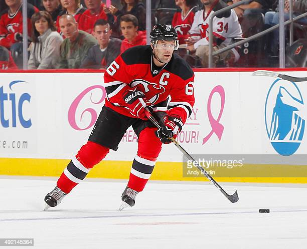 Andy Greene of the New Jersey Devils plays the puck against the Winnipeg Jets during the game at the Prudential Center on October 9 2015 in Newark...