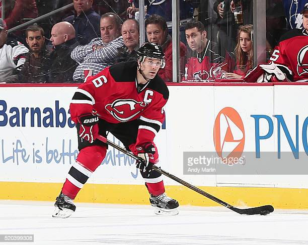 Andy Greene of the New Jersey Devils plays the puck during the game against the Tampa Bay Lightning at the Prudential Center on April 7 2016 in...
