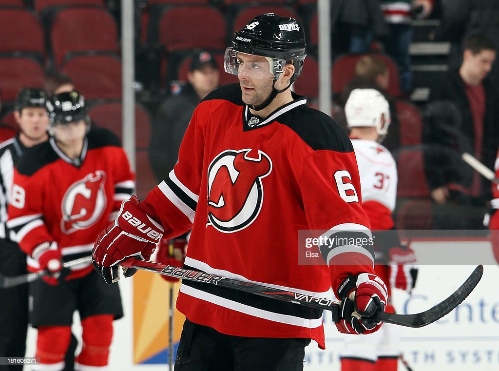 <a gi-track='captionPersonalityLinkClicked' href=/galleries/search?phrase=Andy+Greene&family=editorial&specificpeople=3568726 ng-click='$event.stopPropagation()'>Andy Greene</a> #6 of the New Jersey Devils reacts after losing to the Carolina Hurricanes at the Prudential Center on February 12, 2013 in Newark, New Jersey.The Carolina Hurricanes defeated the New Jersey Devils 4-2.