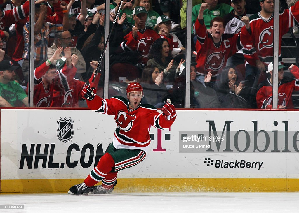 <a gi-track='captionPersonalityLinkClicked' href=/galleries/search?phrase=Andy+Greene&family=editorial&specificpeople=3568726 ng-click='$event.stopPropagation()'>Andy Greene</a> #6 of the New Jersey Devils scores at 16:57 of the first period against the Pittsburgh Penguins at the Prudential Center on March 17, 2012 in Newark, New Jersey.