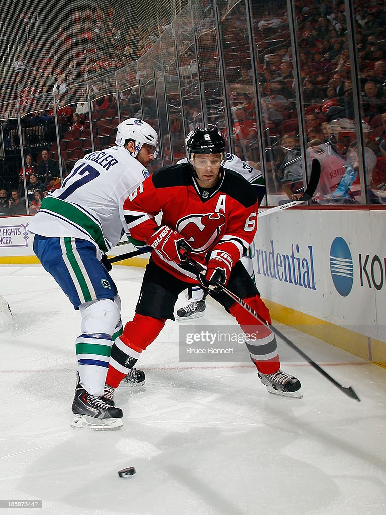<a gi-track='captionPersonalityLinkClicked' href=/galleries/search?phrase=Andy+Greene&family=editorial&specificpeople=3568726 ng-click='$event.stopPropagation()'>Andy Greene</a> #6 of the New Jersey Devils skates against the Vancouver Canucks at the Prudential Center on October 24, 2013 in Newark, New Jersey. The Canucks defeated the Devils 3-2 in the shootout.