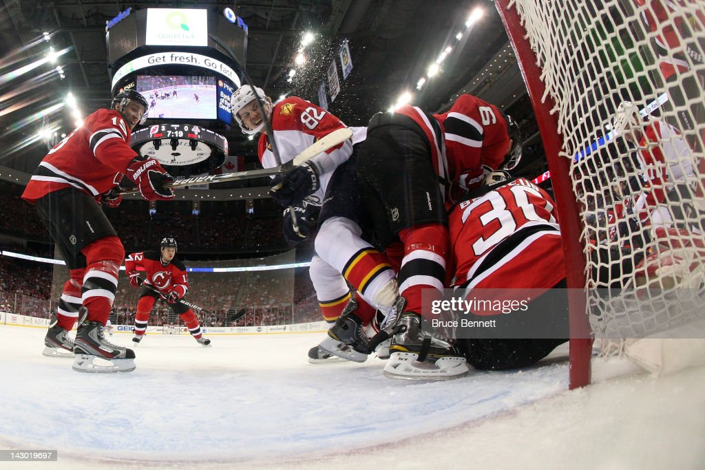 <a gi-track='captionPersonalityLinkClicked' href=/galleries/search?phrase=Andy+Greene&family=editorial&specificpeople=3568726 ng-click='$event.stopPropagation()'>Andy Greene</a> #6 of the New Jersey Devils skates into his teammate goalie <a gi-track='captionPersonalityLinkClicked' href=/galleries/search?phrase=Martin+Brodeur&family=editorial&specificpeople=201594 ng-click='$event.stopPropagation()'>Martin Brodeur</a> #30 in the first period against <a gi-track='captionPersonalityLinkClicked' href=/galleries/search?phrase=Tomas+Kopecky&family=editorial&specificpeople=2234349 ng-click='$event.stopPropagation()'>Tomas Kopecky</a> #82 of the Florida Panthers in Game Three of the Eastern Conference Quarterfinals during the 2012 NHL Stanley Cup Playoffs at Prudential Center on April 17, 2012 in Newark, New Jersey.