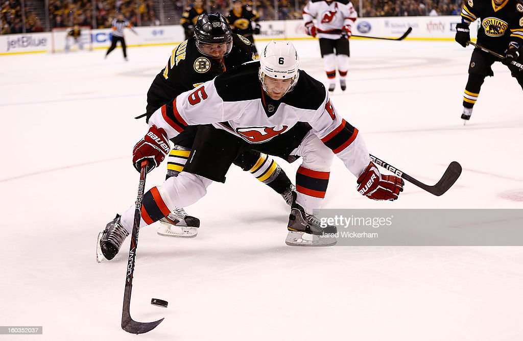 Andy Greene #6 of the New Jersey Devils skates with the puck against Johnny Boychuk #55 of the Boston Bruins during the game on January 29, 2013 at TD Garden in Boston, Massachusetts.