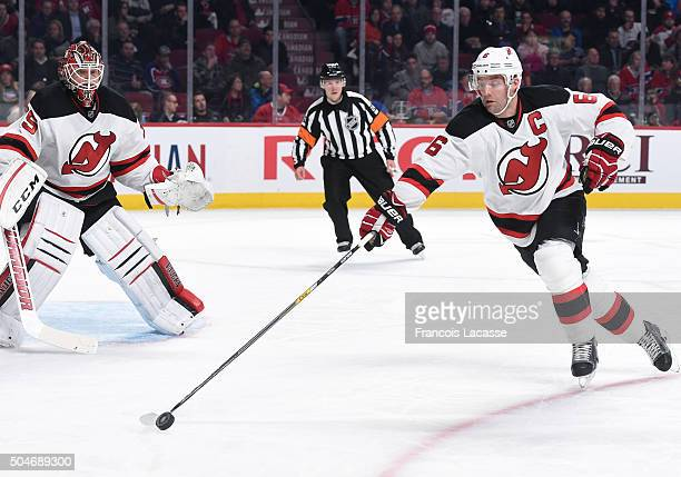 Andy Greene of the New Jersey Devils stickhandles the puck away from the Montreal Canadiens in the NHL game at the Bell Centre on January 6 2016 in...