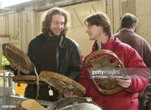 Andy Greening and Simon Chappell members of the Telecommunications Heritage Group examine engineer's snow shoes which form part of a lot in an...