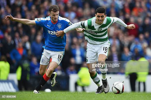 Andy Halliday of Rangers holds Tomas Rogic of Celtic during the William Hill Scottish Cup semi final between Rangers and Celtic at Hampden Park on...