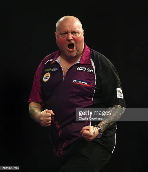 Andy Hamilton of England celebrates winning a set during his first round match against Joe Murnan of England during the 2016 William Hill PDC World...