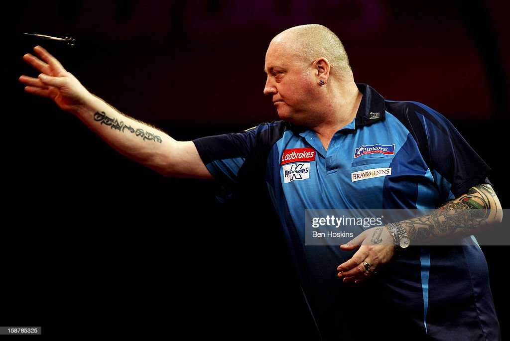 Andy Hamilton of England in action during his quarter final match against Phil Taylor of England on day twelve of the 2013 Ladbrokes.com World Darts Championship at the Alexandra Palace on December 28, 2012 in London, England.