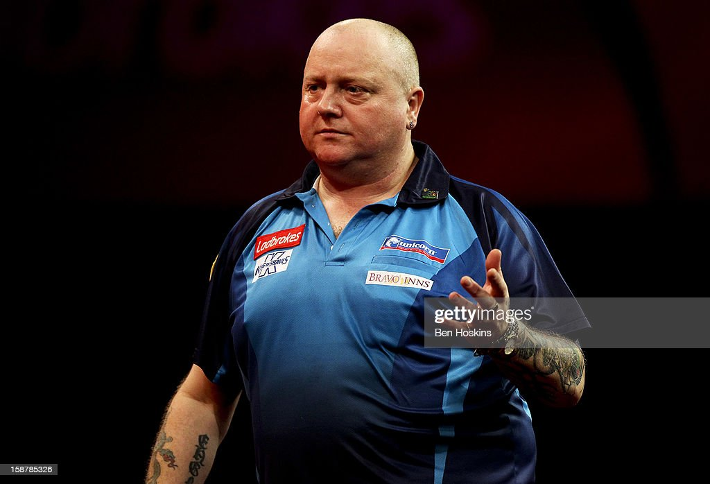 Andy Hamilton of England reacts during his quarter final match against Phil Taylor of England on day twelve of the 2013 Ladbrokes.com World Darts Championship at the Alexandra Palace on December 28, 2012 in London, England.