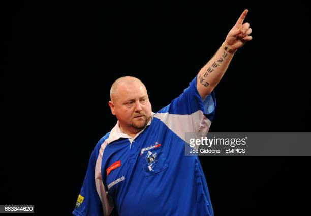 Andy Hamilton reacts during his third round match against Jelle Klaasen