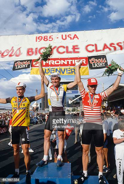 Andy Hampsten of the USA Bernard Hinault of France and Greg Lemond of the USA stand on the podium following the Denver Criterium stage of the 1985...