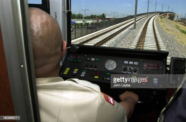 Andy Hina Light Rail driver drives the Light Rail train over the bridge just north of Bellview during a Media day ride on the Light Rail's southwest...