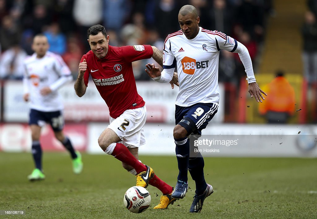 <a gi-track='captionPersonalityLinkClicked' href=/galleries/search?phrase=Andy+Hughes&family=editorial&specificpeople=786021 ng-click='$event.stopPropagation()'>Andy Hughes</a> of Charlton competes for the ball with David Ngog (R) of Bolton during the npower Championship match between Charlton Athletic and Bolton Wanderers at the Valley on March 30, 2013 in London, England.