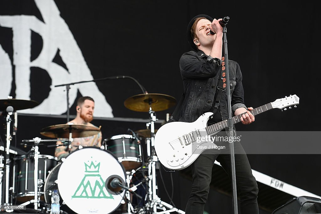 Andy Hurley and Patrick Stump of Fall Out Boy perform at The Isle of Wight Festival at Seaclose Park on June 15 2014 in Newport Isle of Wight