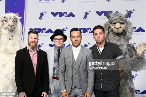 Andy Hurley Patrick Stump Pete Wentz and Joe Trohman of musical group Fallout Boy arrive at the MTV Video Music Awards 2017 In Inglewood California...