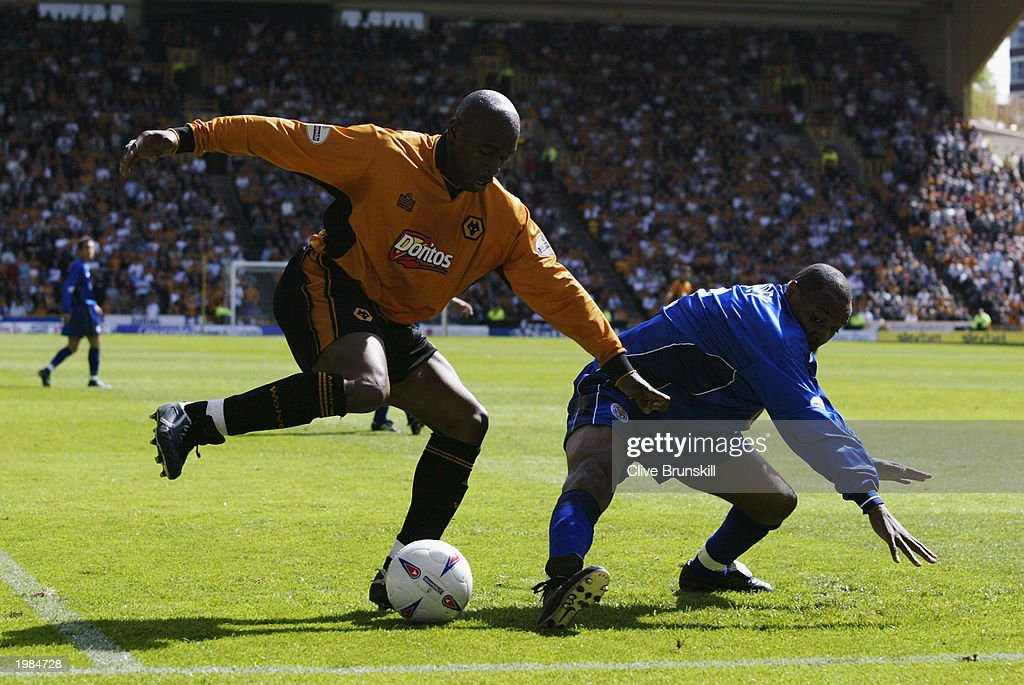 Andy Impey of Leicester City attempts a tackle on Shaun Newton of Wolverhampton Wanderers during the Nationwide First Division match between Wolverhampton Wanderers and Leicester City held on May 4, 2003 at the Molineux Stadium in Wolverhampton, England. The match ended in a 1-1 draw.
