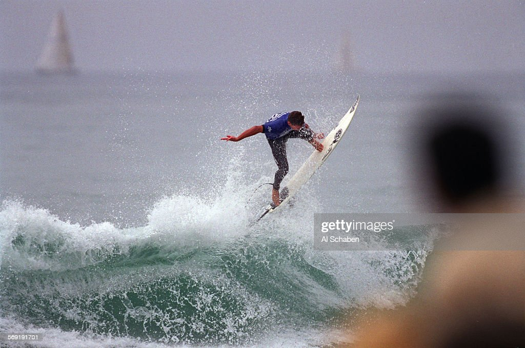 Andy Irons of Hawaii gets some air off of Saturday's bigger waves much to the fans' approval during his win over Jake Patterson of Australia in the...
