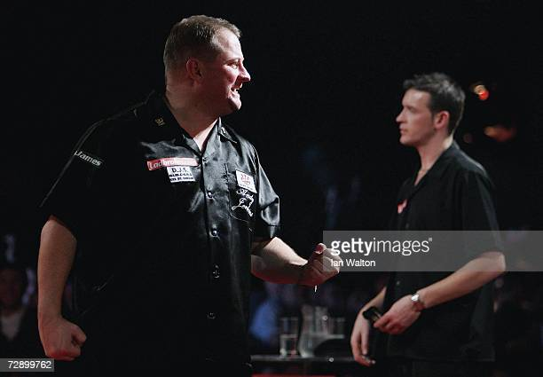 Andy Jenkins of England celebrates beating Colin Osborne of England during the quarterfinals of the Ladbrokes World Darts Championship at The Circus...