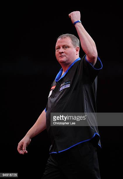 Andy Jenkins of England celebrates winning a leg against Peter Manley of England during the 2010 Ladbrokescom World Darts Championship Round One at...