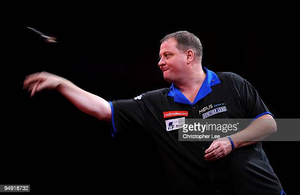 Andy Jenkins of England in action against Peter Manley of England during the 2010 Ladbrokescom World Darts Championship Round One at Alexandra Palace...