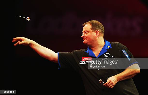 Andy Jenkins of England in action during day 6 of the 2013 Ladbrokescom World Darts Championship at Alexandra Palace on December 19 2012 in London...